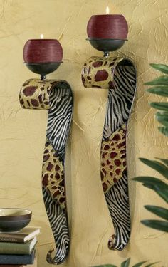 Set of 2 Safari Sconces   from Midnight Velvet.   The exotic mix of zebra and giraffe prints on these gracefully curved sconces calls to mind images of the African veldt and its untamed appeal.
