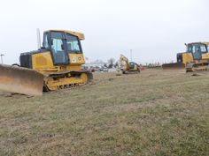 2 John Deere bulldozers.550K closest to camera & 450J in the background