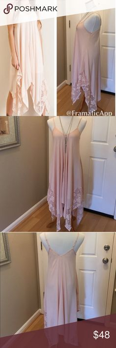 "Lace Handkerchief dress This is a NWT Handkerchief Dress in a pretty light peach/blush color. Bottom sides are lined with a pretty lace detail. Has built in slip and adjustable straps. Material is 100% rayon. ⚜Please see my ""reasonable offers"" listing at the top of my page before submitting an offer⚜Thank you😊 Boutique Dresses Maxi"