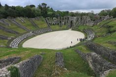 It's not so easy to locate this huge, ruined Roman amphitheater in Saintes, France. But it's well worth the effort. You can climb all around it and even walk out into the middle of it. No crowds and no fake gladiators to spoil the mood!  There's also a Roman arch and a bridge in the town. And here's how nice the people are: we stopped to ask directions of a man on a bicycle, and he had us drive behind him while he biked quite a distance to show us the way there.