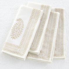 Do a basic woodblock or use a stencil and gold fabric paint on white for elegant table linens for the holidays and beyond