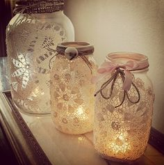 Lace doilies on jars and turned into candle holders, nice idea