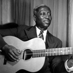 Leadbelly: Huddie William Ledbetter was an iconic American folk and blues musician, and multi-instrumentalist, notable for his strong vocals, his virtuosity on the twelve-string guitar, and the songbook of folk standards he introduced.