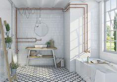Utanpå liggande rör kan användas som en snygg detalj. Här kombineras kopparrör med vita men effektfulla kakelplattor och ett neutralt mönstrat golv.