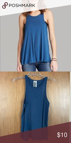 Classic Free People tank in blue! Worn once. Great comfy shirt, only worn once, great condition. Free People Tops Tank Tops