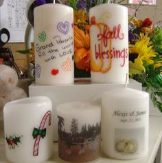 Draw image on tissue paper, place on candle, wrap with wax paper, heat until image is transferred.