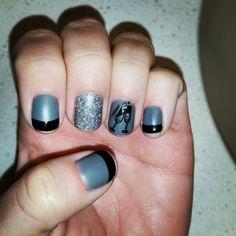 Matte gray gel polish, shiny tuxedo black gel polish, silver sparkles, champagne glasses cheers, NYE