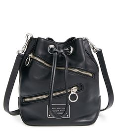 Add a bit of attitude to the street-chic ensemble with this too-hot-to-handle Marc Jacobs zip leather bag.