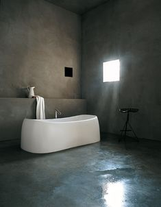WABI SABI Scandinavia: Concrete Bath The contrast of clean white with concrete works well with subdued light from a small aperture.