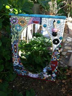 Beautiful mosaic garden mirror.  Great work Michelle!!