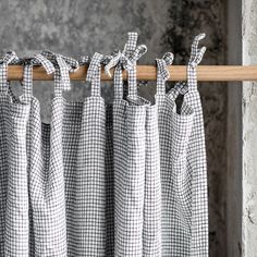 Washed and handmade linen curtains in small checks.  ++++++++++++++++++++++++++++++++++++++++++++++++++++++++++++++++++  LOOK  Washed, soft and has naturally born wrinkles after washing process. The linen is of medium weight so it is not sheer though it is not blackout and lets the lightening inside.  ++++++++++++++++++++++++++++++++++++++++++++++++++++++++++++++++  FINISH  The panel comes with ties, rod pocket or a hem for clipping. Please make a choice on the right.  TIES  - Each panel has…