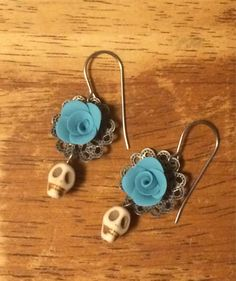 The dainty earrings are the perfect balance of sweet and scary. The hand made roses on a filigree backing add a softness to these earrings. The