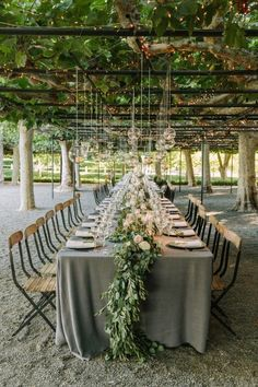 Bright lights illuminate this beautiful outdoor Napa wedding at Beaulieu Gardens. Photos by The Edges Wedding Photography.