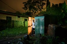 Michael Christopher Brown HONDURAS. San Pedro Sula. 2015. Kelvin Villanueva on his aunt's property. He had been living and working illegally in Kansas City when he was deported to his home country of Honduras.