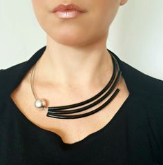 Fabulous contemporary asymmetrical necklace made of rubber plastic tube, steel wire string cord and silver acrylic bead. The length of the necklace is 58cm (22.8). A must have accessory to jazz up your wardrobe. Package will be shipped out as soon as I possibly can which is usually 3 - 5
