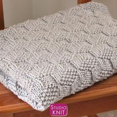Sweet new blanket pattern! Studio Knit's Knitted Blanket Pattern in Tumbling Blocks Pattern is an easy knit and purl design great for beginners. Sizes Available: Baby Stroller Blanket, Receiving Blanket, Lapghan Blanket, Blanket Throw, Twin Bedspread, + Queen Bedspread. #StudioKnit #knitblanket #knittingpattern #couverturebebetricot Circular Knitting Needles, Easy Knitting, Knitting For Beginners, Knitting Stitches, Afghan Crochet Patterns, Baby Knitting Patterns, Knitted Baby Blankets, Knit Picks, Yarn Projects