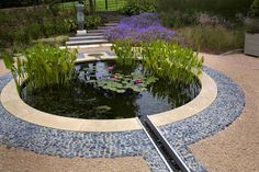 In this garden, a large circular pool is the major feature with water gently cascading down a stainless steel rill set into central steps leading to a terrace below