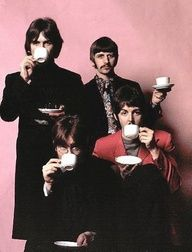 The Beatles...drinking tea!!  ...or gin. Maybe water. Hell, we'll never know.