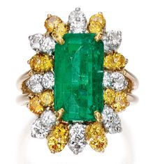 18 KARAT GOLD, PLATINUM, EMERALD, COLORED DIAMOND AND DIAMOND RING, OSCAR HEYMAN & BROTHERS Centering an emerald-cut emerald weighing 5.42 carats, framed by round diamonds of yellow hue weighing 1.36 carats and round near colorless diamonds weighing 1.30 carats, size 6½, numbered 12454, with maker's mark. With signed box.