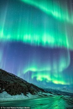 More transfixing images of the Northern Lights inStorslett (left) andDjupvik (right) taken by the 31-year-old Norwegian photographer