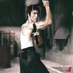 Bruce Lee interlocked.