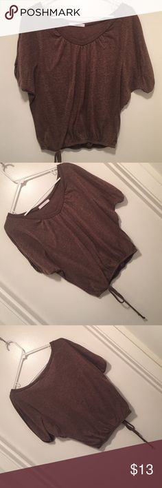 NEW Brown shirt. Make offers! Brown shirt that tightens at the bottom! Looks new! Tops Blouses