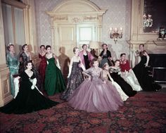 Fashion models displaying a selection of gowns designed for the Coronation of Queen Elizabeth II, at Claridges, London, 1953 by dovima_is_devine_II on Flickr