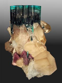 Tourmaline var. Indicolite, Lepidolite and Quartz on Albite and Ortoclase