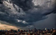 Inga Sarda-Sorensen - dark storm clouds looming over the New York skyline