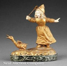 A French Gilt Bronze and Ivory Figural Group of a Young Girl Chasing a Duck with…