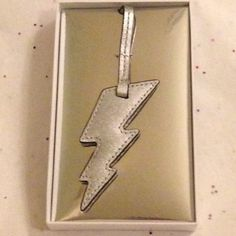 "Michael Kors silver lightning bolt charm NWT Metallic silver leather lightning bolt handbag charm, approx 3.5"" Michael Kors Accessories Key & Card Holders"