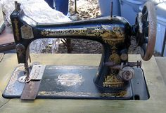 vintage sewing machine.  Tole painted