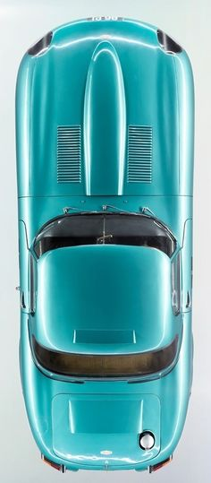 Lightweight racing E-Type...in a very odd colour....K