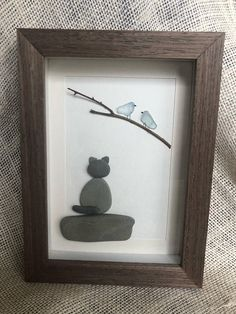 This piece was created for Persia and Kiara, our two cats, who may enjoy bird watching a bit too much! It was created using sea glass, driftwood, and pebbles found locally in Lake Erie. It was then placed on a 5X7 canvas and put inside a shadowbox (with a glass cover) . Buy one today for