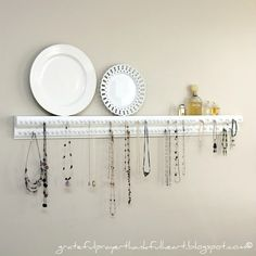 Organize your necklace and bracelets.  A few pieces of wood trim and upholstery tacks.