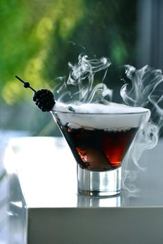 The GHOST: - Canada dry - Ice - Cranberry juice  - Chambord - BlaVod Vodka - Garnish black rasberry - Somehow get it to smoke