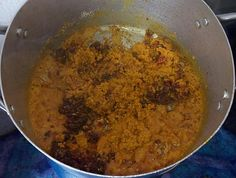 Frying of egusi in palm oil for afang soup