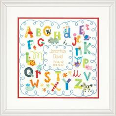 Dimensions Alphabet Birth Record - Cross Stitch Kit. A colorful alphabet and cute creatures are featured in this adorable Alphabet Birth Record (Birth Announcem