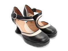 "Named for and designed by Vancouverite Elif for John's Open Source Footwear Program (OMG! If you don't know about this click on Fluevog's Open Source). Built upon the classic Fluevog Mini heel, this Mary Jane inspired shoe with a wide strap of high grained aniline vegetable-tanned leathers is sure to fit all shapes of feet. Elif's design made John stand up and declare her design an OSF ""Chosen"" design. We hope you are as excited as John is. Go on, fall in love. We dare you!   Instagram…"