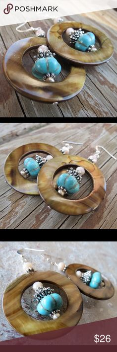 Brown MOP Shell Earrings Turquoise Cream Crystals Large round brown mother of pearl shell earrings with turquoise magnesite and cream colored crystals.  Handmade / One of a Kind / New with Tags Handmade Jewelry Earrings