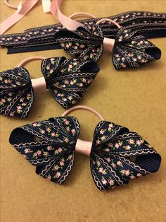 Navy and pink hairbows on thin bobbles - www.dreambows.co.uk #handmade #ribbons #butterflies #flowers #flowerhairclips #crafting #craftingwithribbon #passionforcrafting #lovetocraft #lovehandmade #dreambows #pink #black #white #hairclips #hairslides