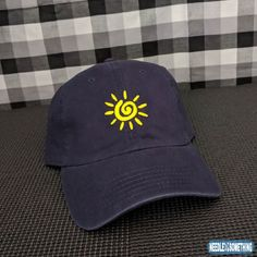 The sun is shining bright this summer, not only in the sky but on top of your head while wearing our Sun Spiral Navy Blue Embroidered Hat/Cap!     #Sun #Shining #Sunshine #Summertime #SummerFun #Vacation #Beachbums #Embroidered #Gifts #Hats #Caps #Yellow