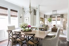 Eclectic White Dining Room with Iron-and-Oak Chandelier