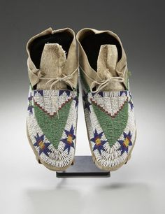 55145: A PAIR OF SIOUX BEADED HIDE MOCCASINS c. 1890 s : Lot 55145