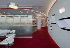 Dupont innovation center by Arch group, Moscow. The wheel is rolling and creating inspiring shapes. I like the red carpet too.  It's a dynamic and energetic office design.