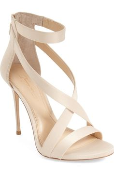 Completely head over heels for this alluring strappy sandal from Vince Camuto. An ankle strap flatters and lengthens the leg, while a back zip closure finishes the look with an edgy touch.
