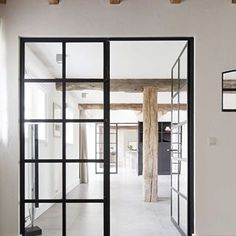 Exposed beams + black framed doors! 😍 | Renovated Farmhouse Designed by Dorset schulkes Architects #dorsetschulkesarchitects #doretschulkesinterieurarchitectenbni #interiordesign