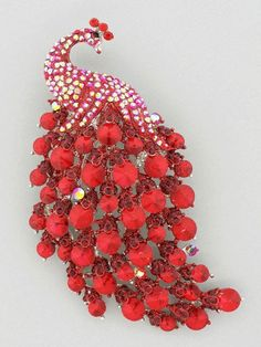 """This extravagant crystal peacock pin/pendant comes in red or multi  4.5"""" x 2.25"""" , $30"""