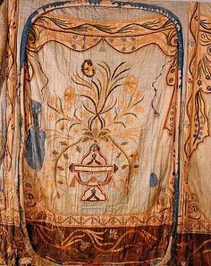 Royal tents used by the Ottoman sultans were miniature palaces, their cloth walls decorated with embroidery and appliqué compositions. This panel from an 18th century tent wall consists of carnations and other flowers springing from a vase. (MILITARY MUSEUM – ISTANBUL).