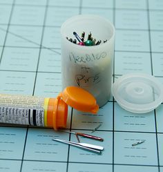 Store broken pins and needles in old film canisters and then toss in trash when full.